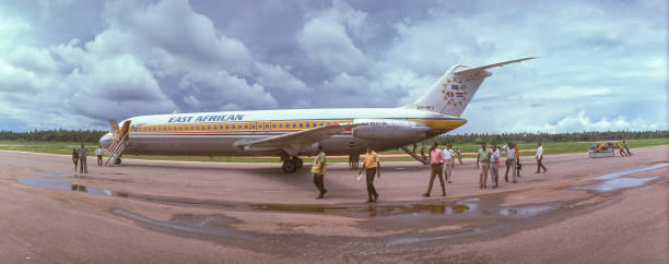 East African Airways DC-9 airplane unloading passengers in 1975 stock photo