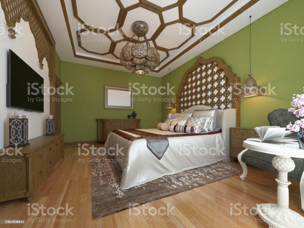 East bedroom, wooden headboard and green walls. TV unit, dressing...