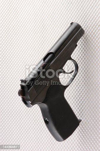 Odd perspective of a small 9mm handgun of the type used by eastern bloc police and military services.