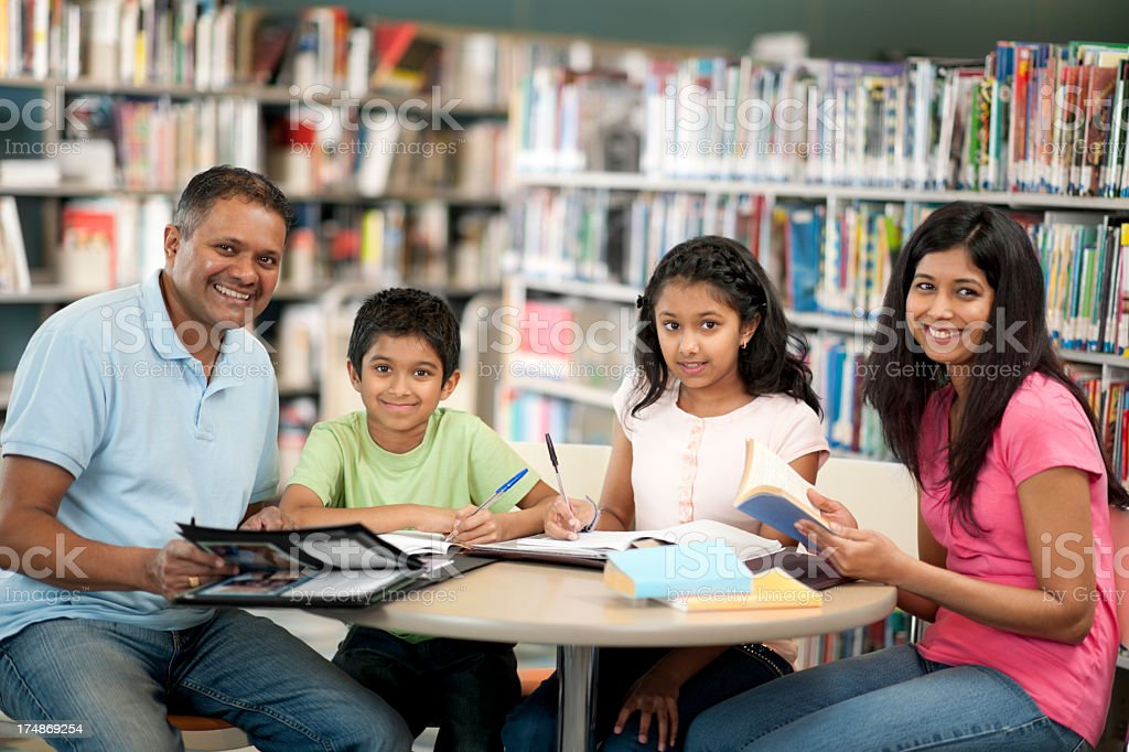 East Indian Family in Library royalty-free stock photo
