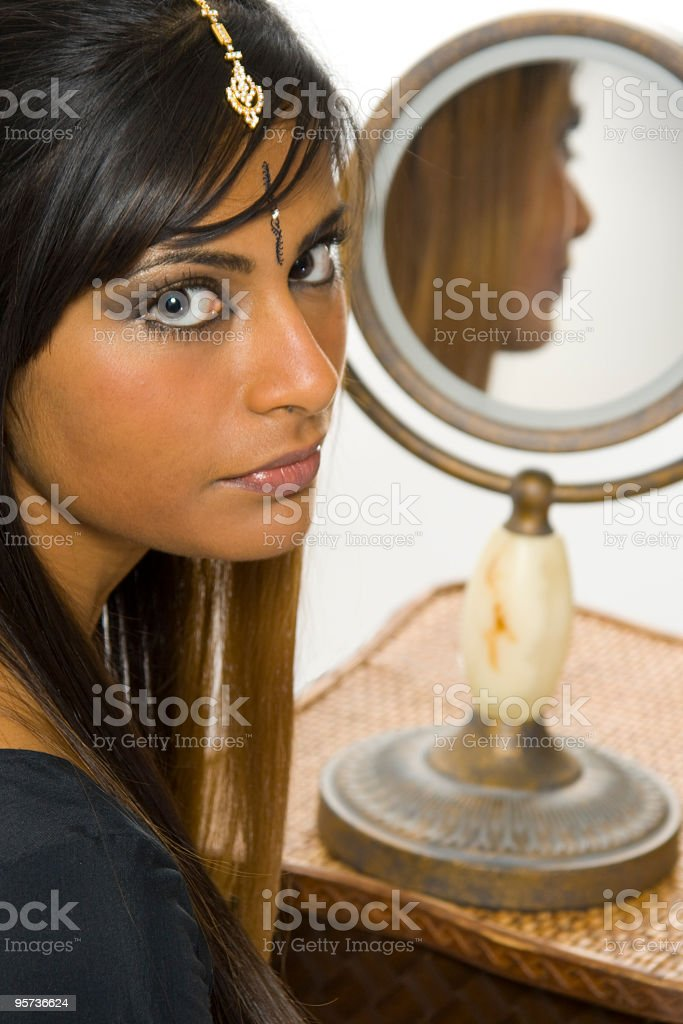 East Indian woman reflected royalty-free stock photo