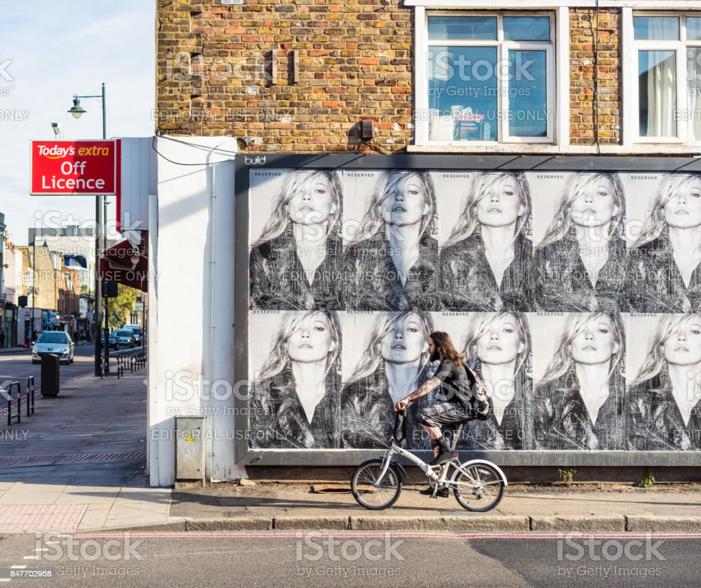 East London street corner with Kate Moss on billboard advertisement stock photo