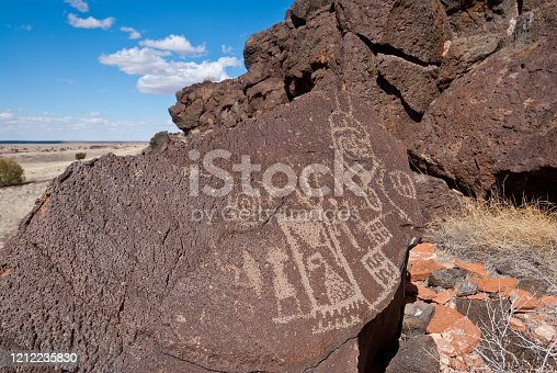 Nearly a thousand years ago natives inhabited the lower elevations around the San Francisco Peaks of Arizona.  In an area so dry it would seem impossible to live, they built pueblos, harvested rainwater, grew crops and raised families.  Today the remnants of their villages dot the landscape along with their other artifacts.  These petroglyphs were found on East Mesa in Wupatki National Monument near Flagstaff, Arizona, USA.
