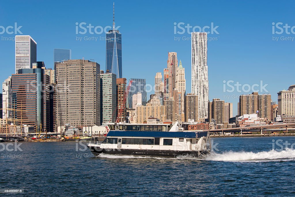 East river ferry boat with the skyline of Lower Manhattan stock photo