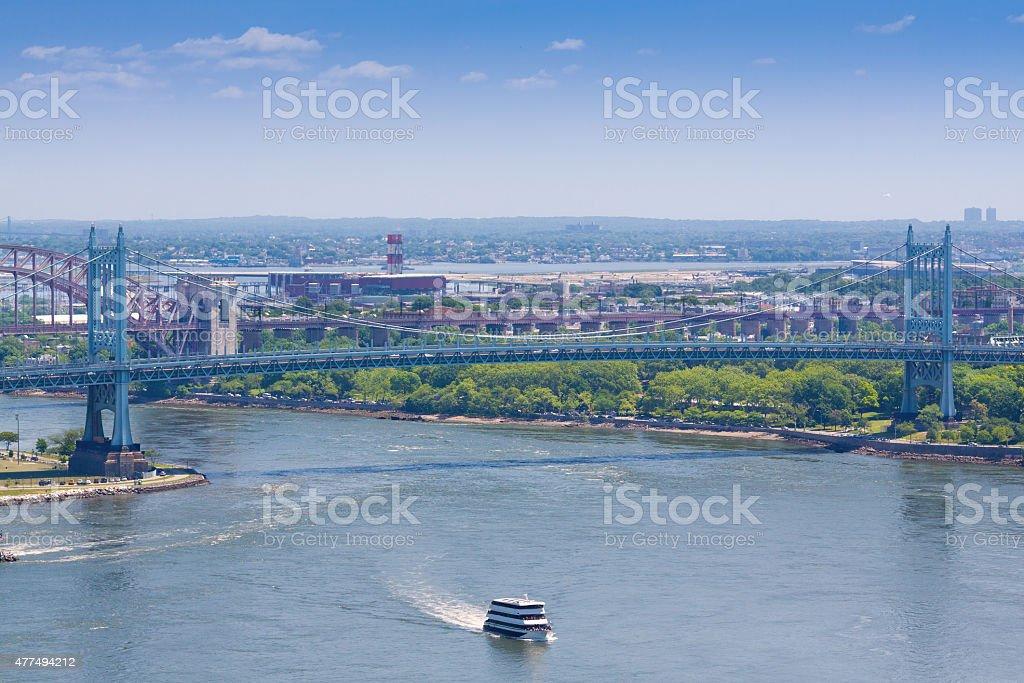 East River with Triborough Bridge, Hell Gate Bridge, New York. stock photo
