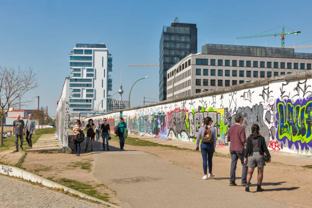 east side gallery in berlin, germany. - berlin wall imagens e fotografias de stock