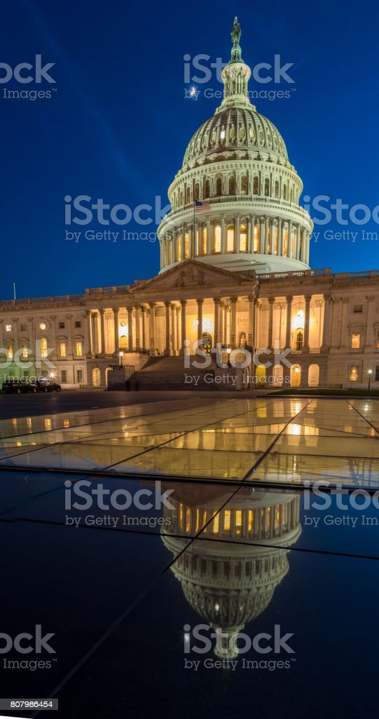 East Side of the US Capitol Reflecting on Glass stock photo