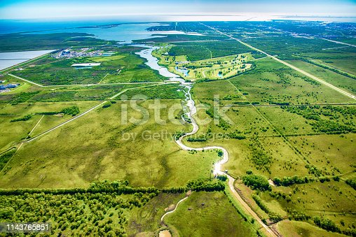 A river known as The Moses Bayou cutting into the rural farmland of West Texas near the Gulf of Mexico coastline near Texas City just north of Galveston.