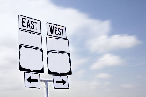 East West Sign with Arrows stock photo