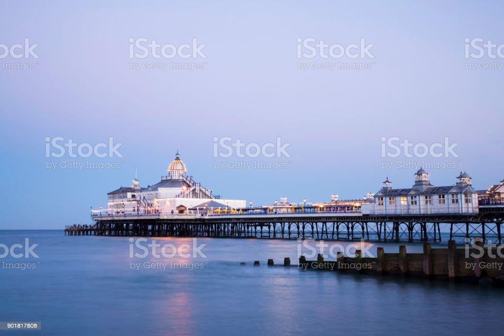 Eastbourne Pier Illuminated at Twilight stock photo