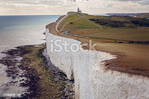 Chalk cliffs, sea, and Belle Toute Lighthouse