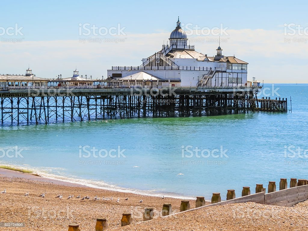 Eastbourne's pier and beach at English Channel, United Kingdom stock photo