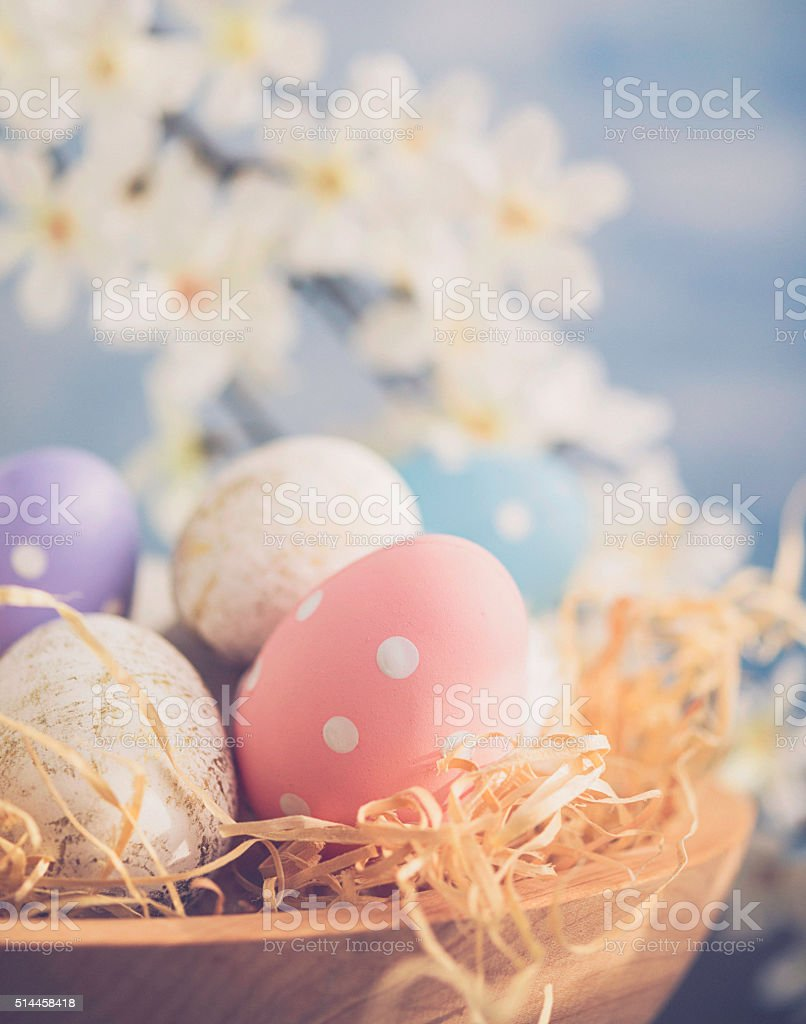 Easter arrangement with decorated eggs and blossoms stock photo