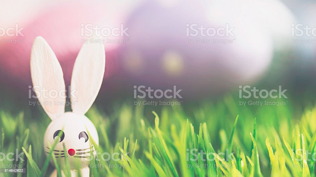 Easter arrangement with decorated eggs and vintage wood bunny stock photo