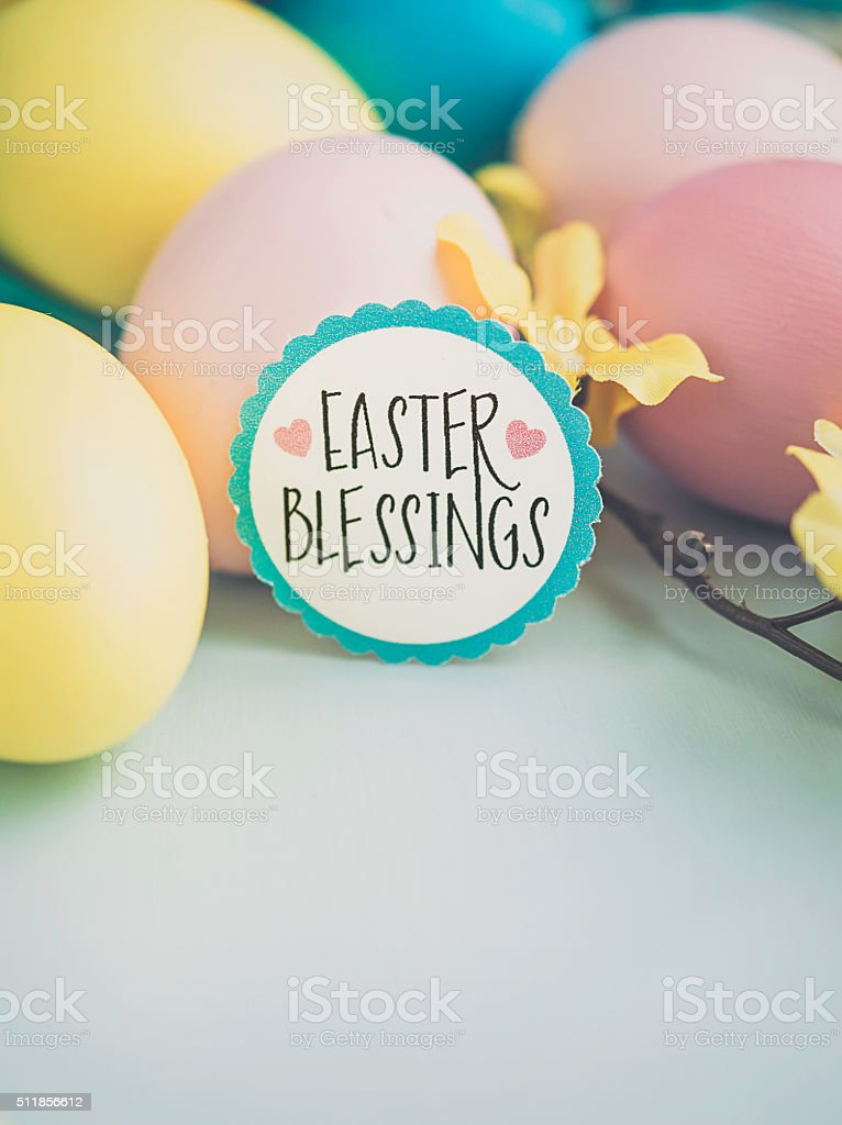Easter arrangement with painted eggs and blossoms stock photo