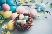 Easter arrangement with painted eggs, blossoms