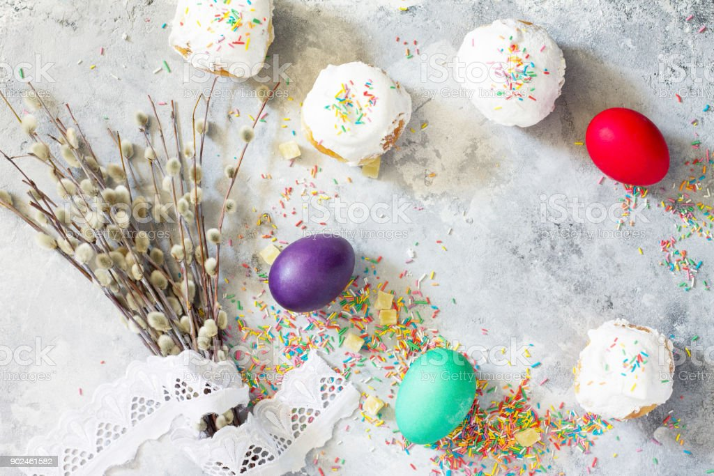 Easter background. Colorful background of Easter with colored eggs on a concrete background with copy space. Flat lay. Top view with copy space. stock photo