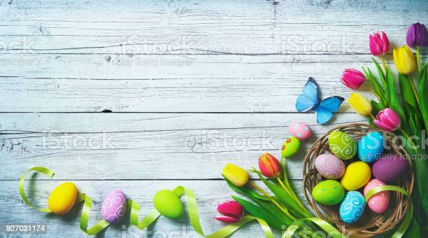 Easter background colorful spring tulips with butterflies and painted picture id927031174?b=1&k=6&m=927031174&s=612x612&h=jbkt27jp7jq7aow1px u3c3 r7pviit9y0s0pu6f8ci=