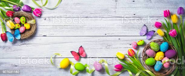 Easter background colorful spring tulips with butterflies and painted picture id927031182?b=1&k=6&m=927031182&s=612x612&h=ks0s0cgfeagjgd2kuxhtuuc8jnzndk tkws7nii73b0=