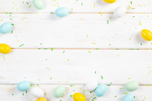 Easter background - cookies shaped like eggs, flowers, bunnies, top view