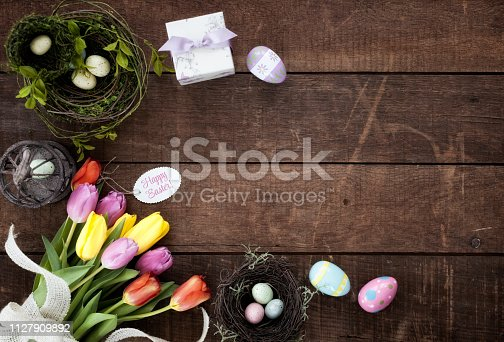istock Easter Background on Old Rustic Wood 1127909892