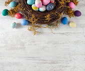 Easter wreath background with colored eggs