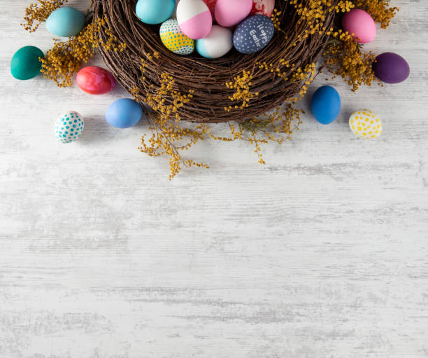 Easter Background Easter wreath background with colored eggs easter stock pictures, royalty-free photos & images