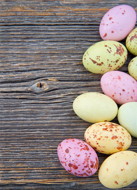 Easter background, small pastel color chocolate eggs stock photo
