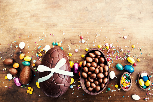Easter Background with Chocolate eggs and copyspace. Top view.  Happy Easter!