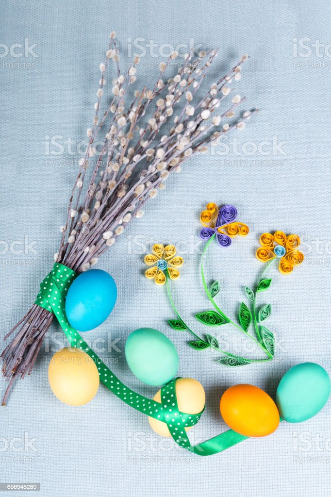 Easter background with clolrful eggs, pussy-willow and paper flowers. stock photo