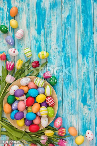 istock Easter Background with Colorful Eggs and Tulips 1133873419