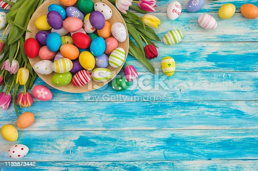 istock Easter Background with Colorful Eggs and Tulips 1133873442