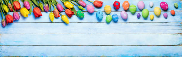 Easter Background With Decorated Eggs And Tulips stock photo