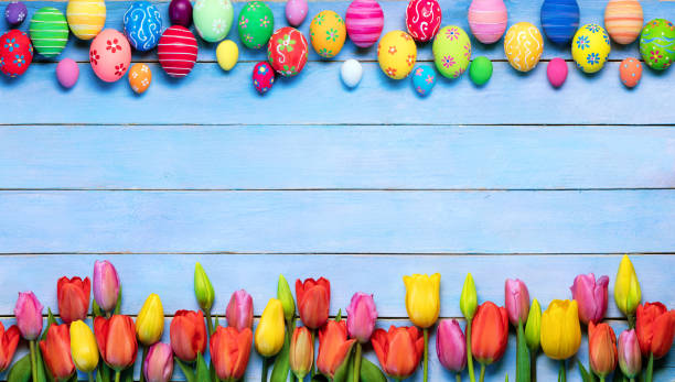 easter background with decorated eggs and tulips - easter foto e immagini stock