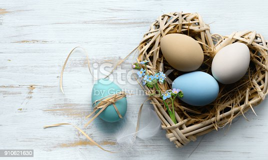 istock Easter background with Easter eggs in nest 910621630