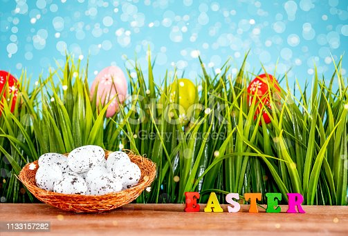 930928526 istock photo Easter background with eggs and green grass 1133157282