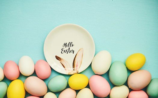colored easter eggs stand in a row on a plain background. 3d illustration