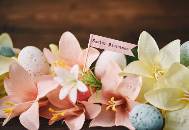 Easter background with lilies and Easter Blessings message stock photo
