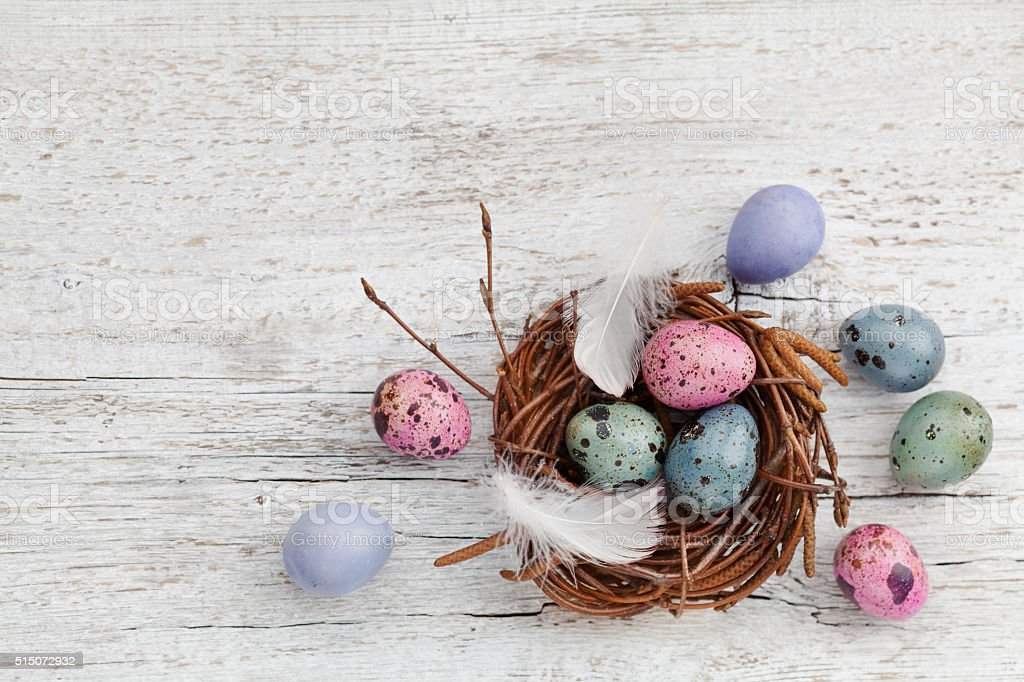 Easter background with painted easter eggs in nest, vintage style stock photo