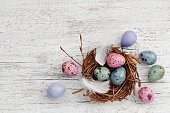 Easter background with painted easter eggs in nest, vintage style