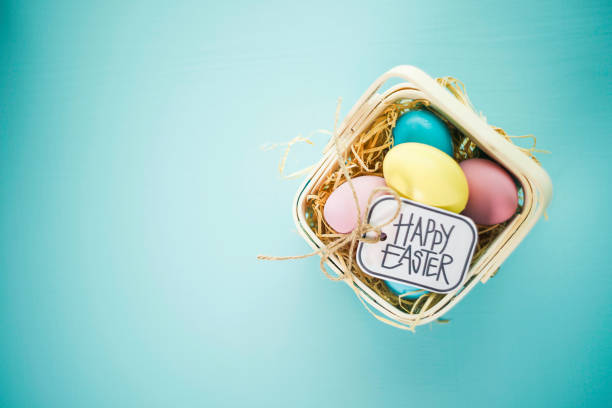 easter background with pastel colored eggs - gift tag note stock photos and pictures