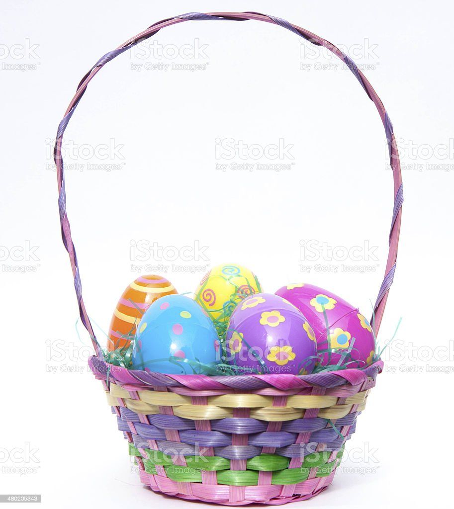 Easter Basket filled with colorful plastic decorative Easter eggs stock photo