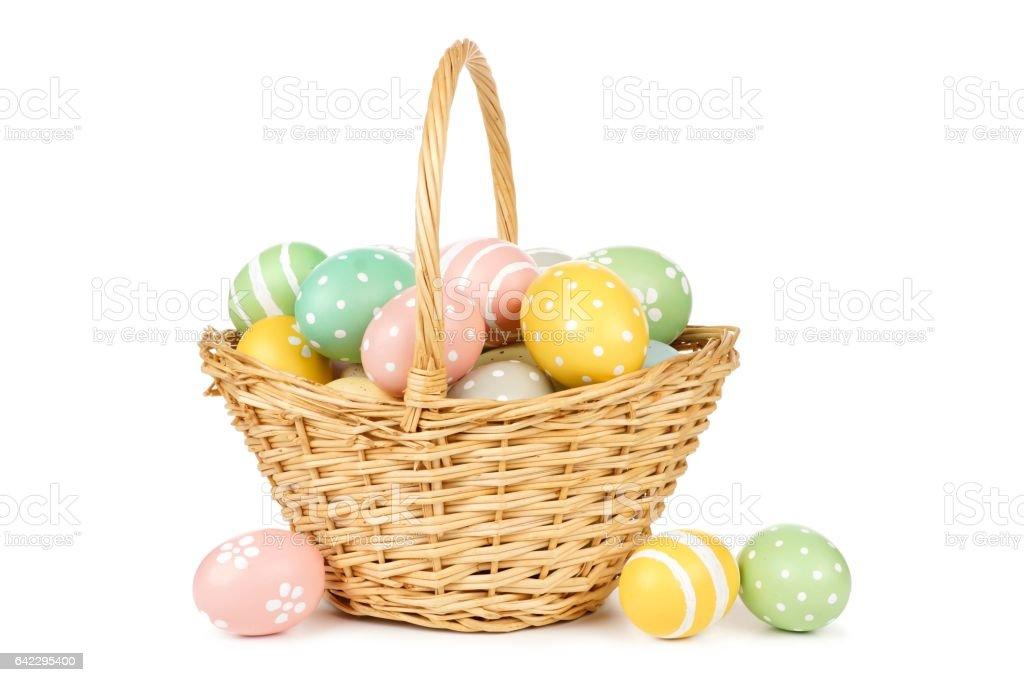 Easter basket filled with Easter Eggs over white stock photo