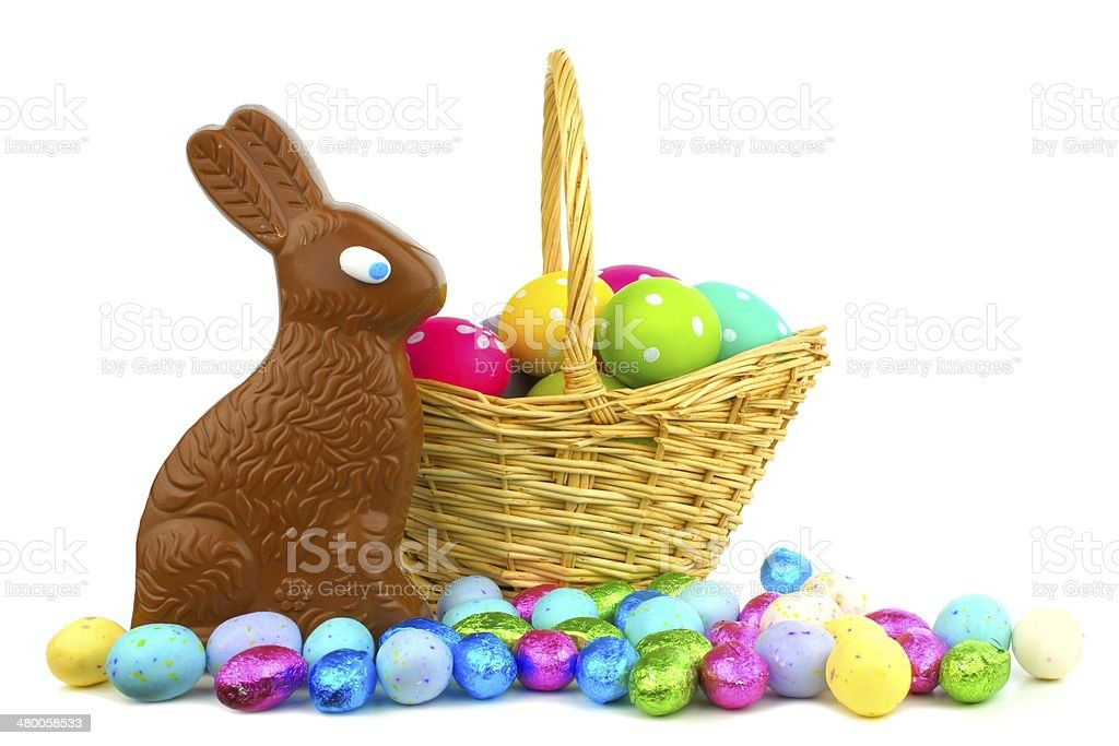 Easter basket filled with eggs and sweets stock photo