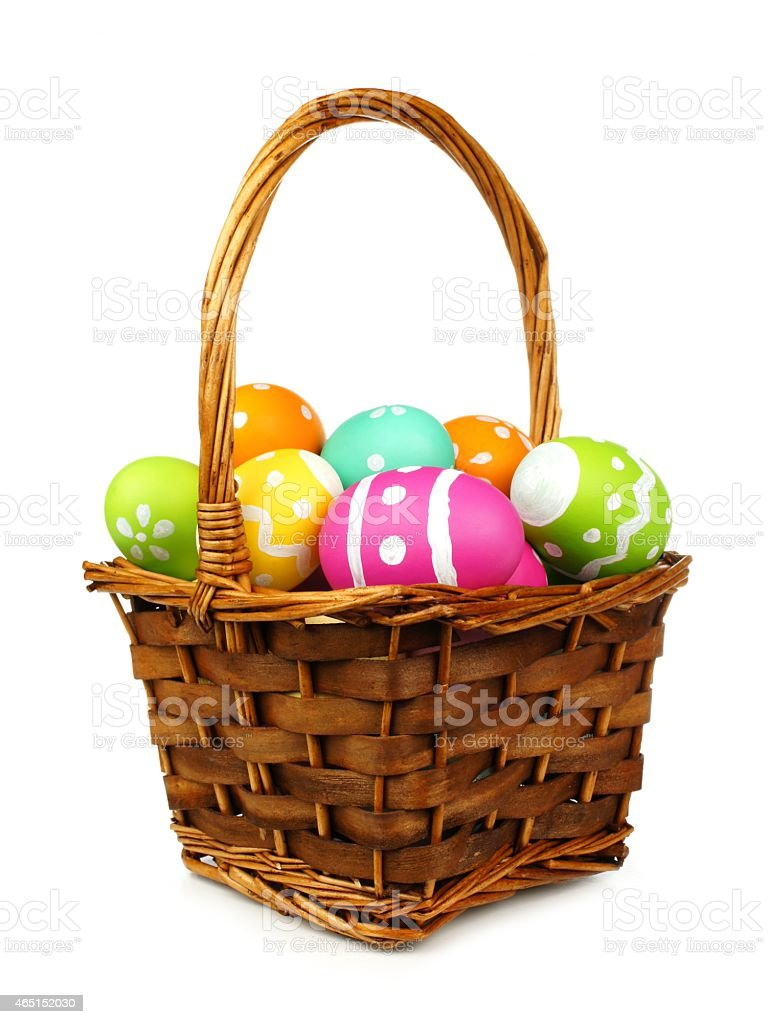 Easter basket of colorful eggs stock photo