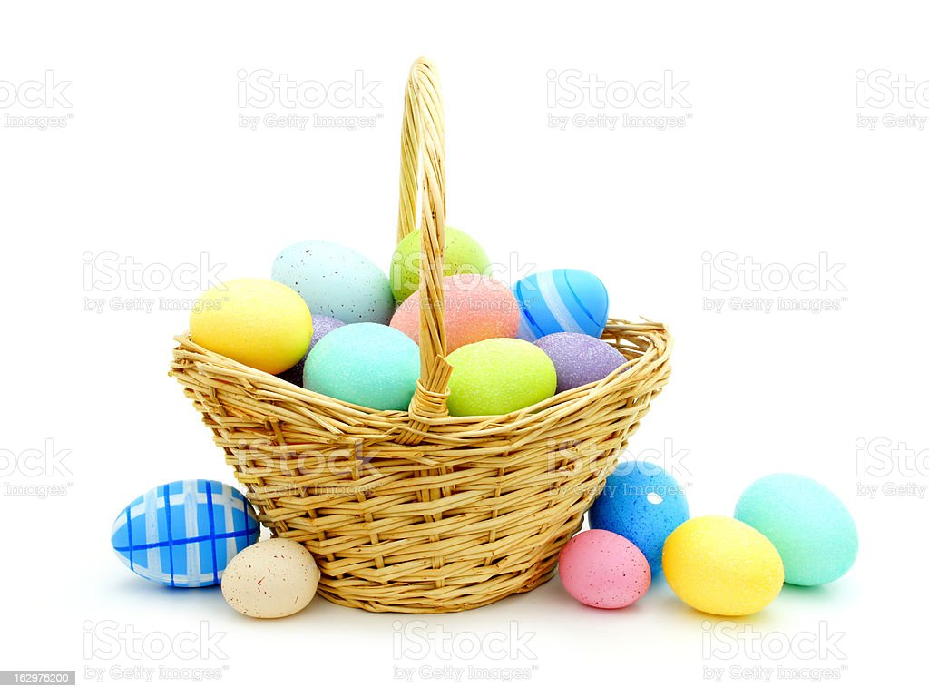 Easter Basket with colorful eggs on white stock photo