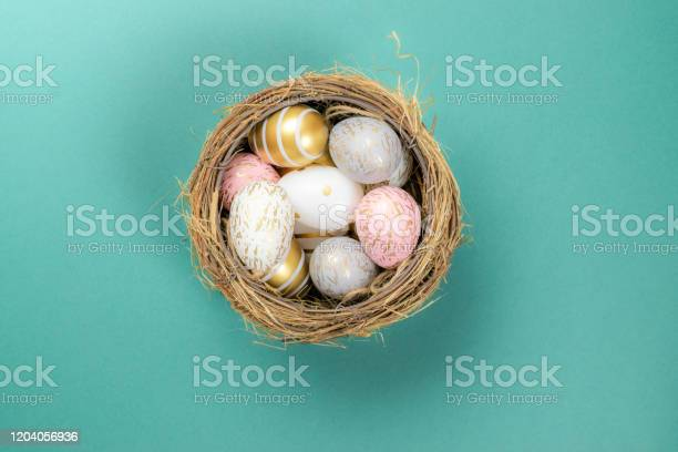 Easter basket with colorful shine decorated eggs isolated on for picture id1204056936?b=1&k=6&m=1204056936&s=612x612&h=kdgo1aa88nuzx08svmjociwnfusfmyykhk74lg4ck7m=
