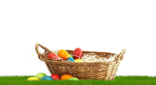 Easter basket with Easter eggs at 3d rendering green grass meadow stock photo