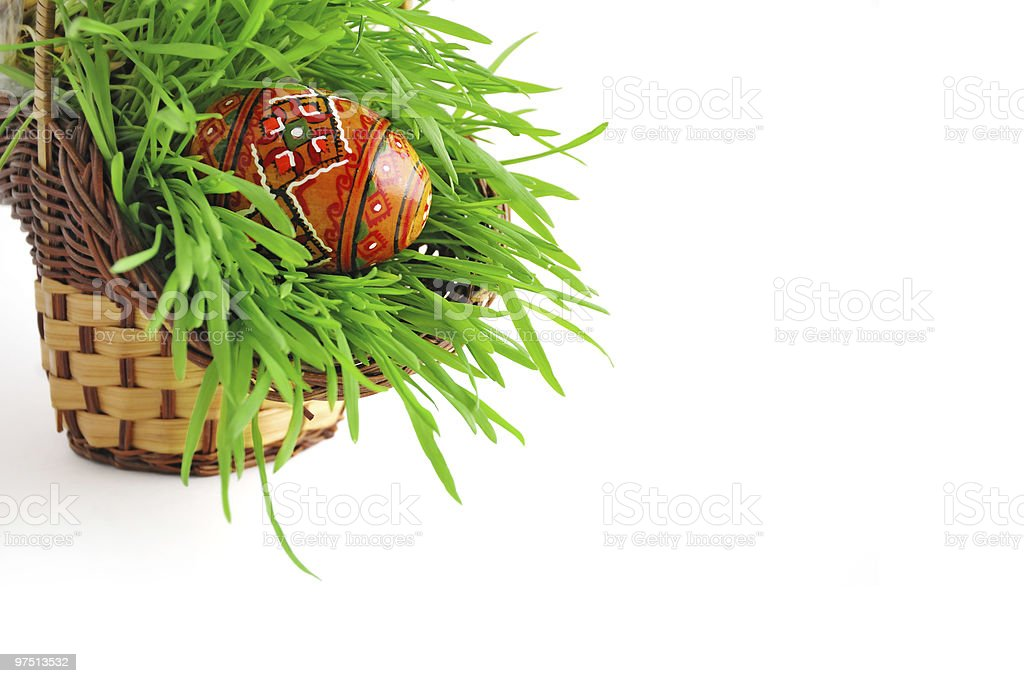 Easter basket with grass and traditional egg royalty-free stock photo