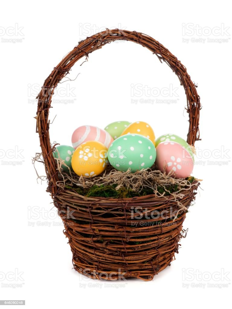 Easter basket with hand painted Easter Eggs over white stock photo